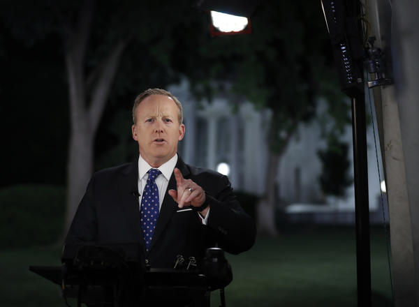 Spicer resigns as an embattled Trump shakes up his press and legal teams