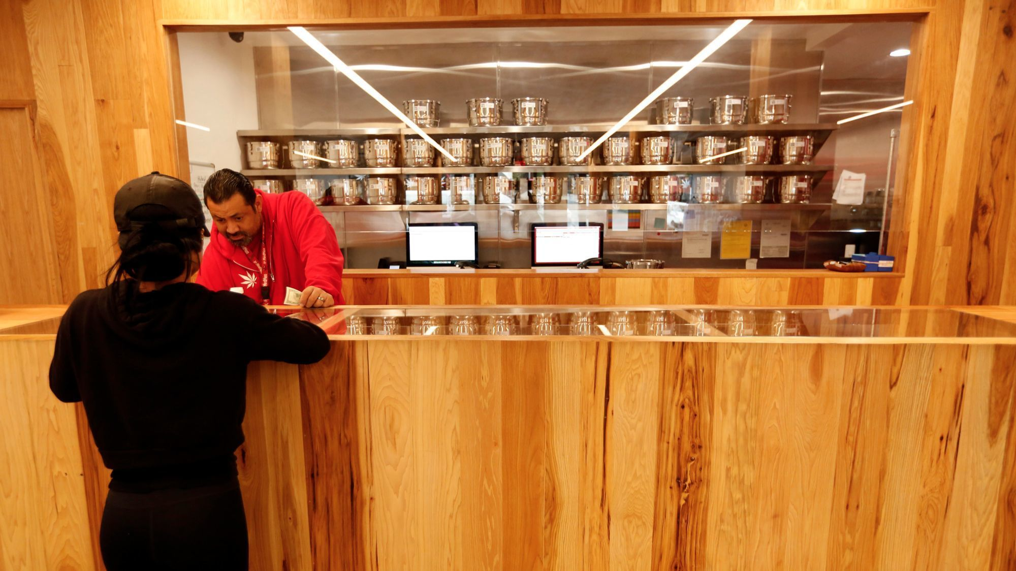Emanuel Garcia fills a customer's order at MedMen cannabis dispensary in Los Angeles last year. (Los Angeles Times)