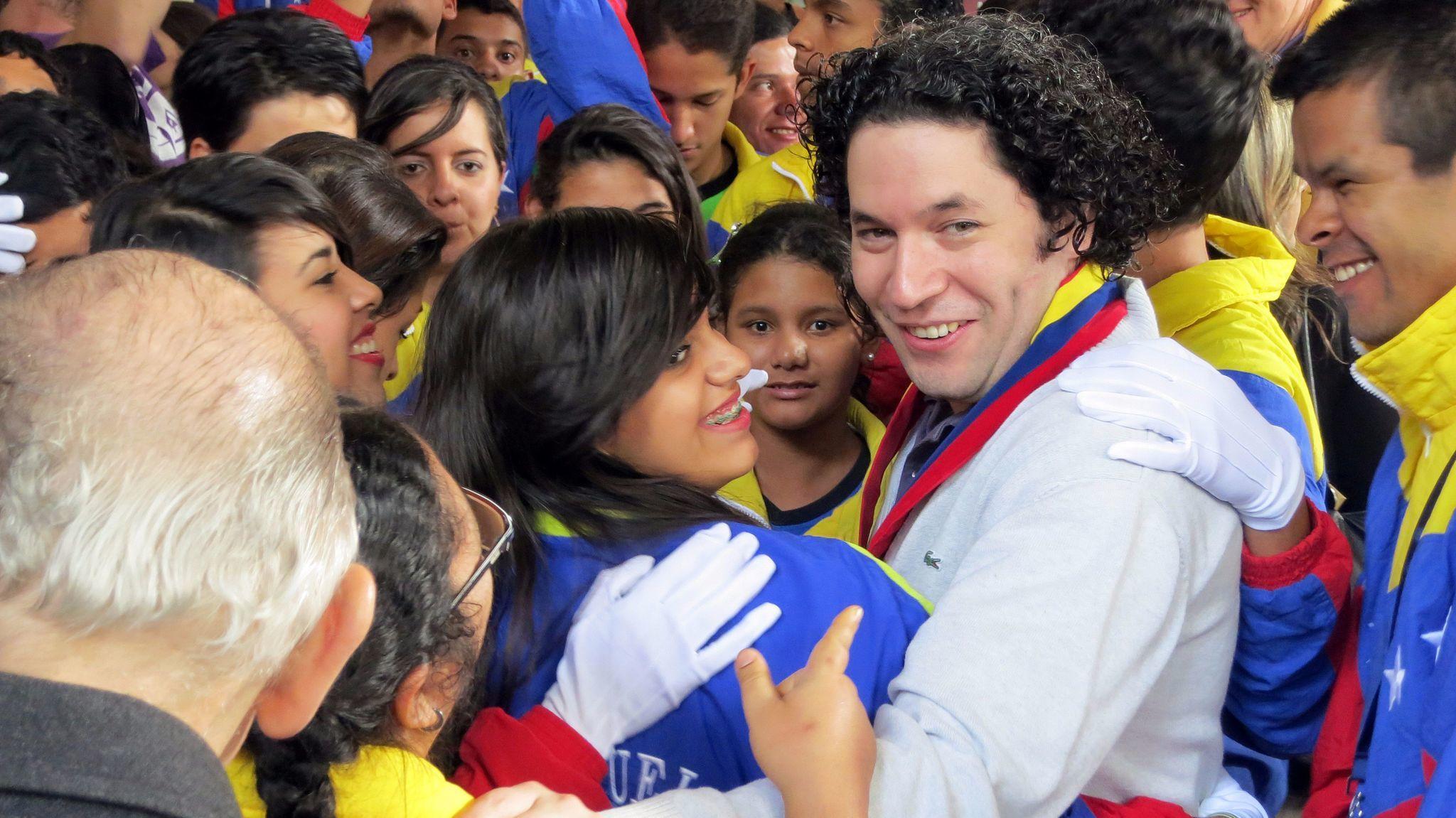 Gustavo Dudamel among students at a 2012 showcase performance of El Sistema students in Caracas, Venezuela. (Mark Swed / Los Angeles Times)