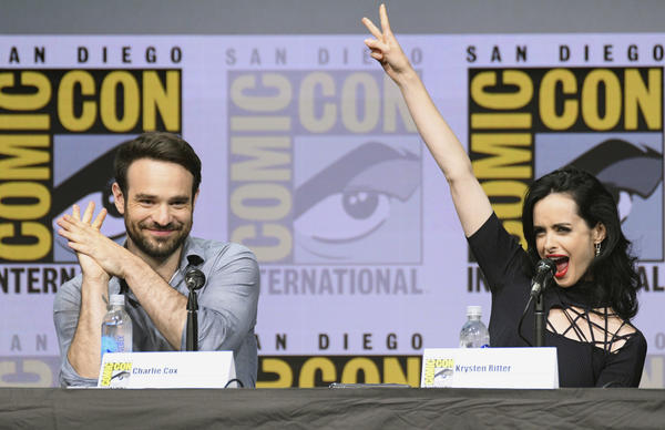 "Charlie Cox (Daredevil) and Krysten Ritter (Jessica Jones) at the ""Marvel's The Defenders"" panel at Comic-Con on Friday night. (Al Powers / Associated Press)"