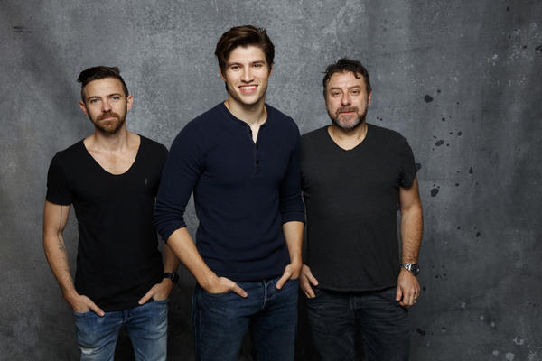"""""""Krypton"""" producers Damian Kindler and Cameron Welsh flank star Cameron Cuffe in the LA Times photo studio at Comic-Con July 22, 2017 (Jay Clendenin/Los Angeles Times)"""