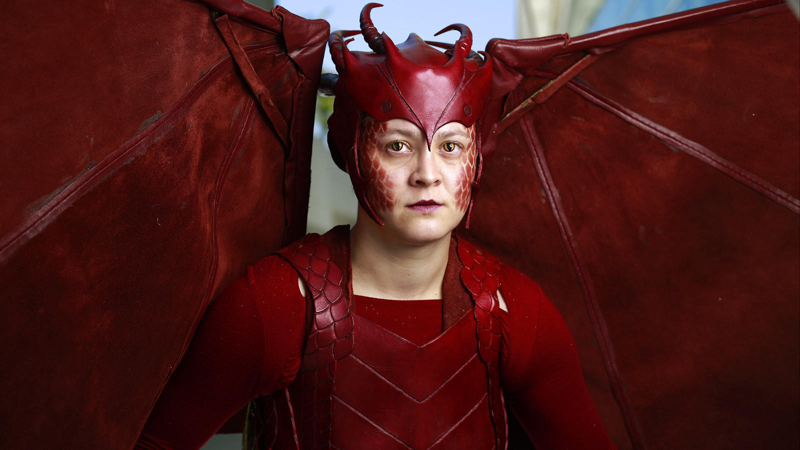 "Vana Ellison of Las Vegas in costume as the dragon Smaug from ""The Hobbit."" (K.C. Alfred / San Diego Union-Tribune)"