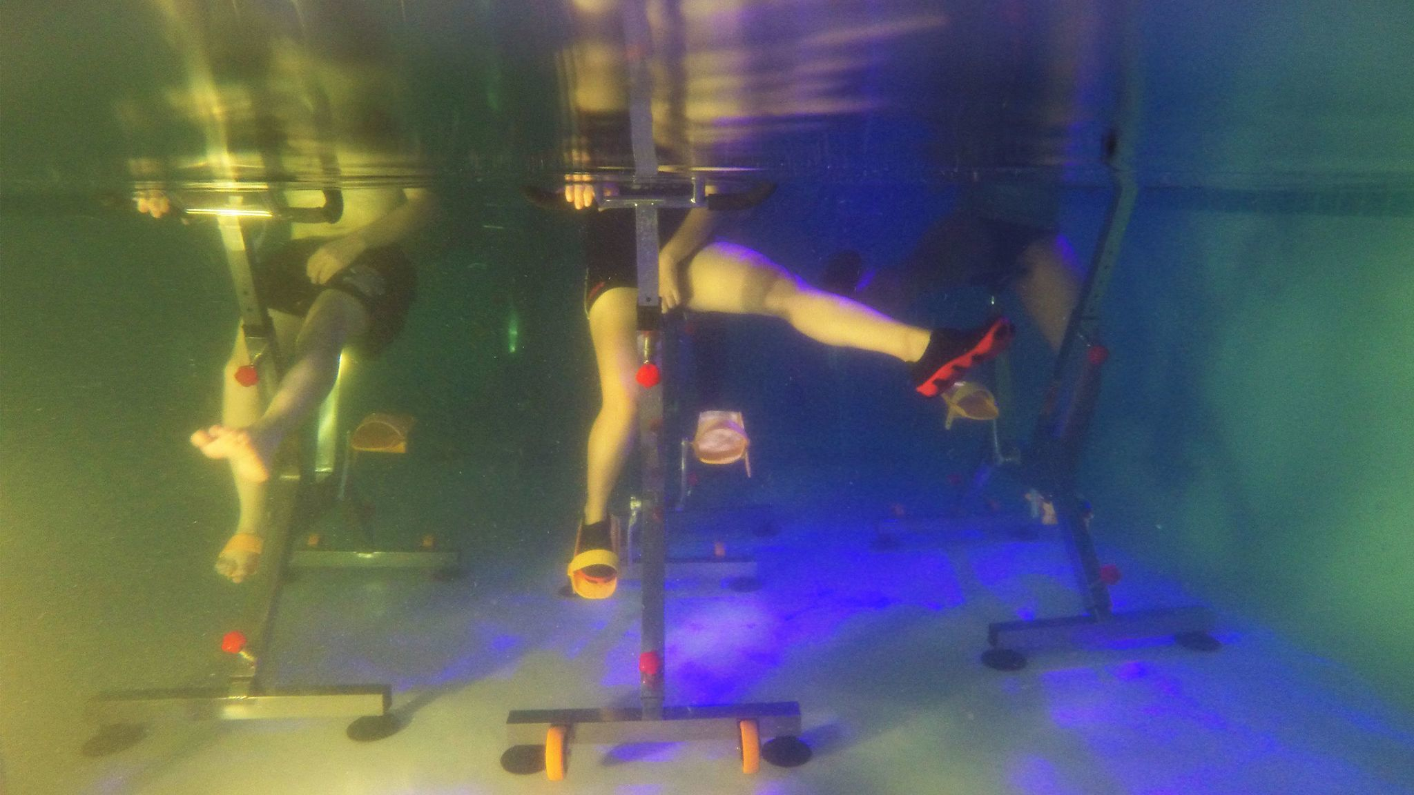 Stretches are key at an underwater spin class.