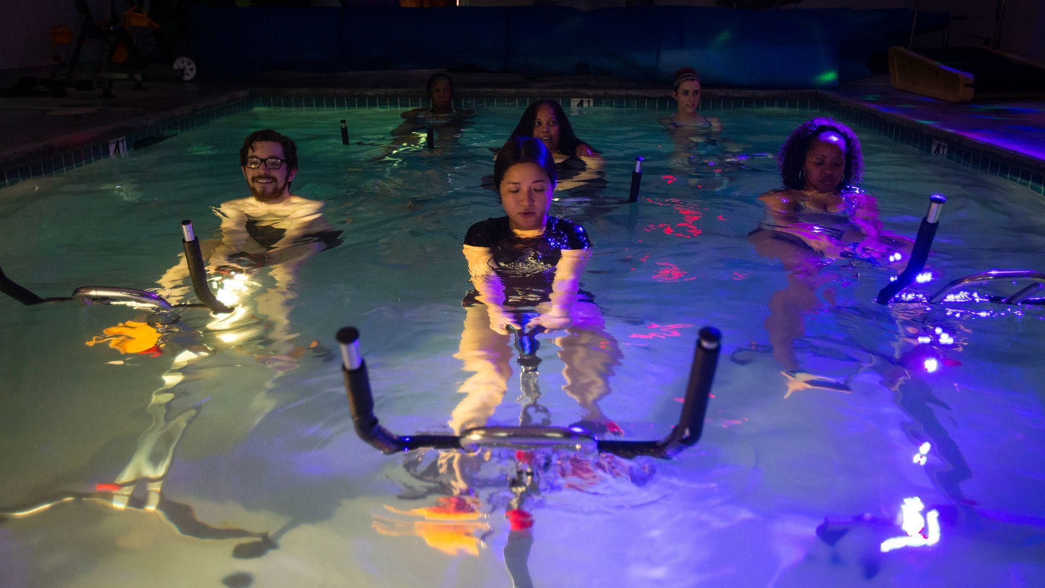 Band work is part of the aqua cycling class.