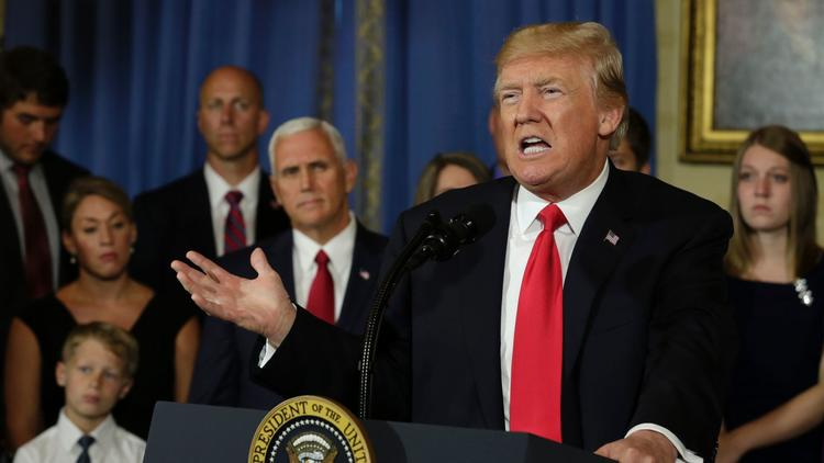 President Trump delivers a statement on healthcare at the White House. (Yuri Gripasyuri Gripas / AFP/Getty Images)