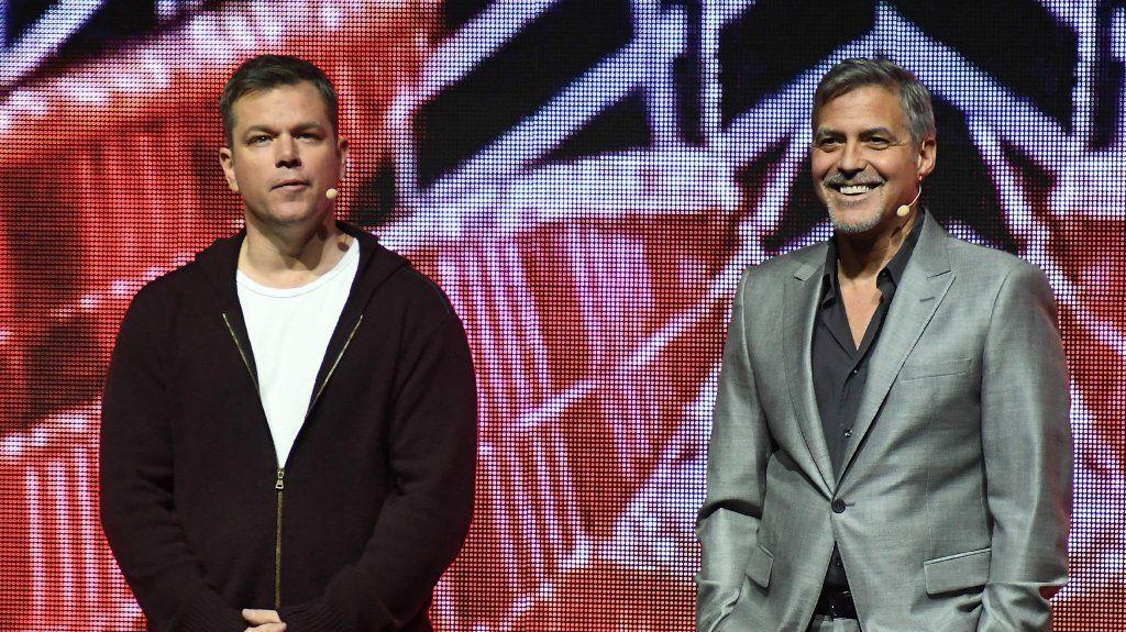 """Matt Damon, left, and George Clooney promote """"Suburbicon"""" at CinemaCon. (Angela Weiss / AFP/Getty Images)"""