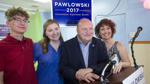 Pawlowski, with his wife Lisa, daughter Mercy, 18 and son Alex, 14, after his victory speech to supp