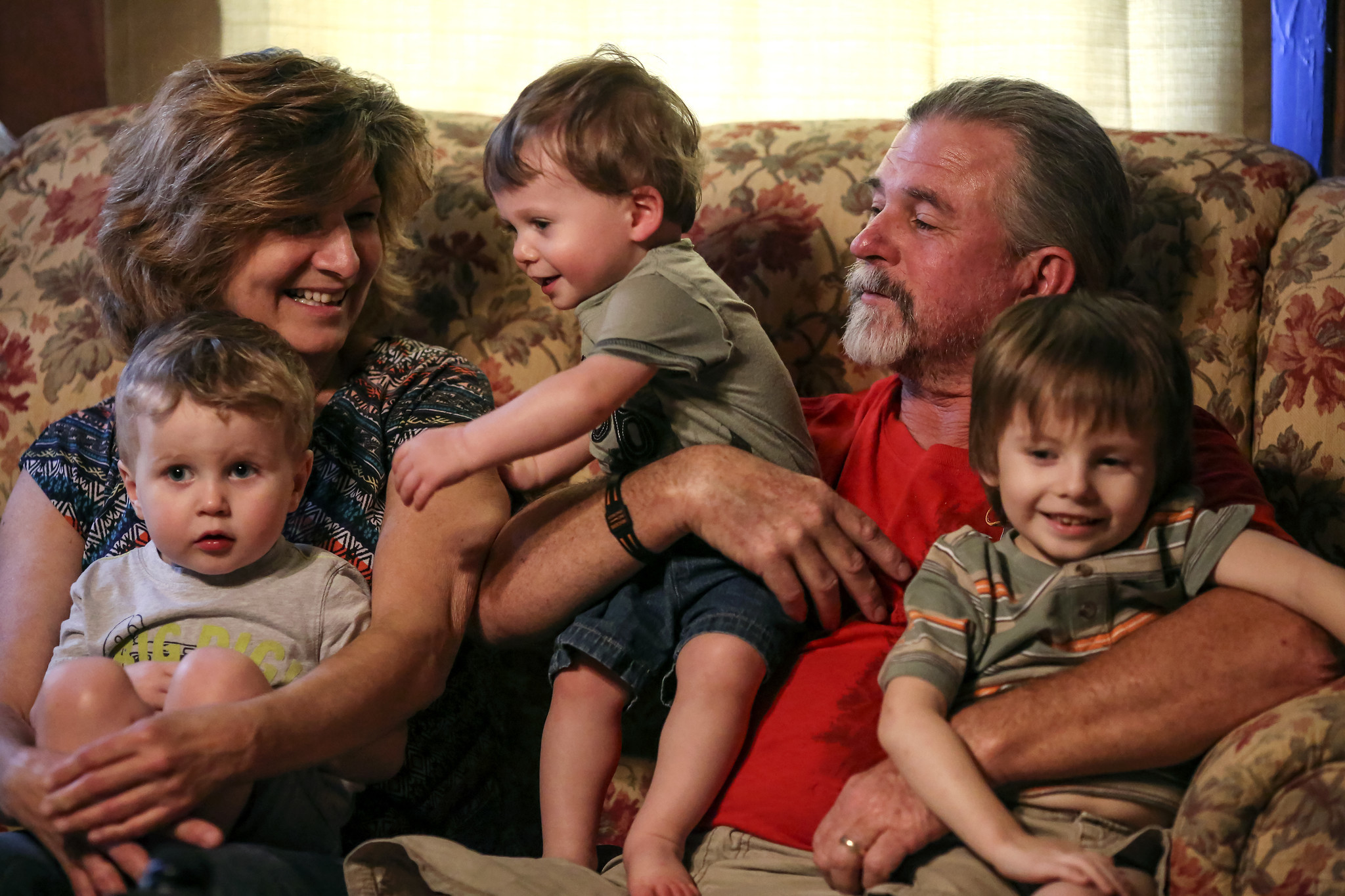 Mike and Lynne Belisle hold their grandchildren Aiden, 2 1/2, Nicholas, 1 1/2, and Joey, 5, (left to right) at their Quincy home.