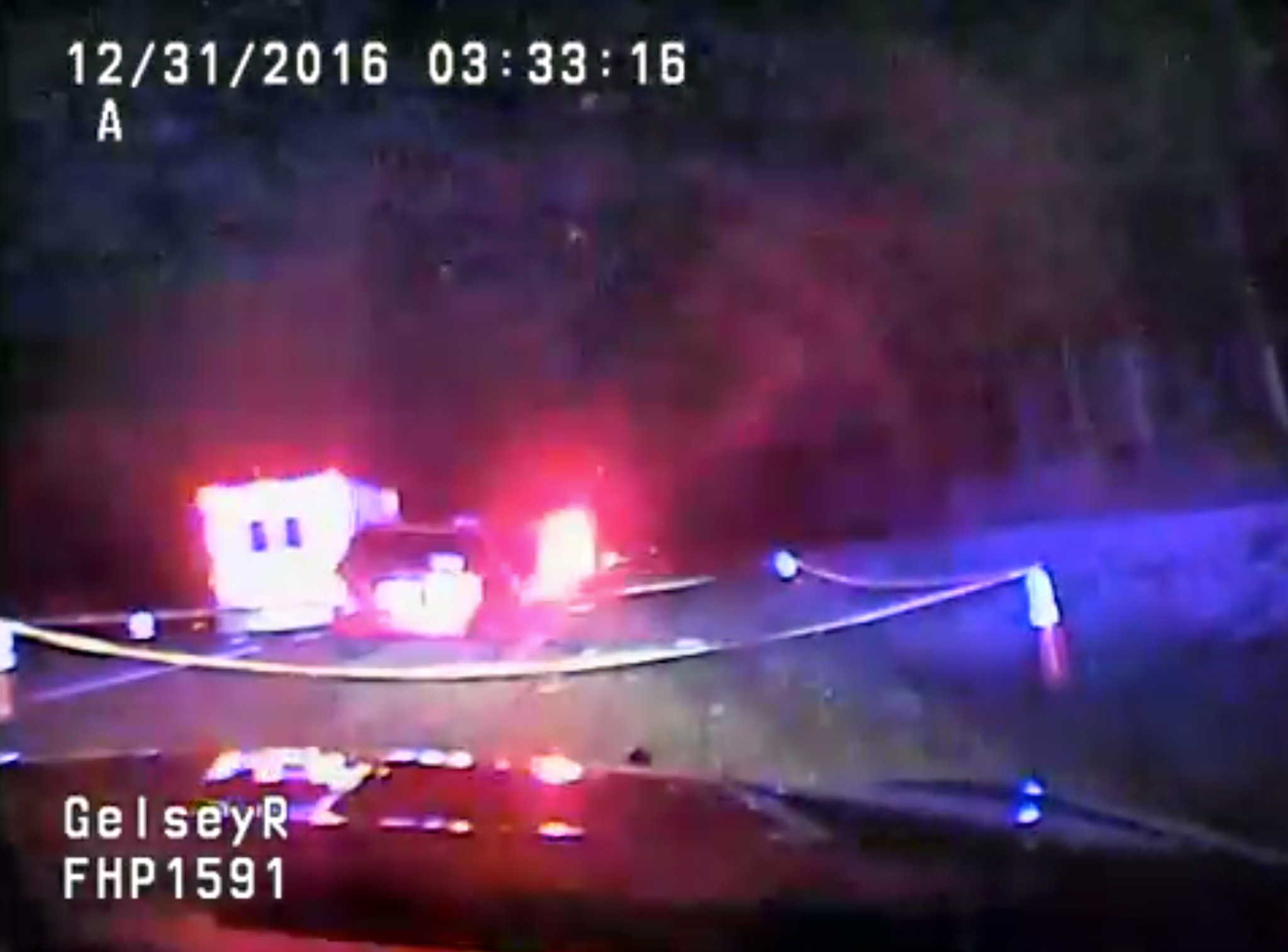 Dash cam footage from Florida Highway Patrol Trooper Richard Gelsey's vehicle shows the Kelsey's car pulled off to the side of I-4. (Florida Highway Patrol)