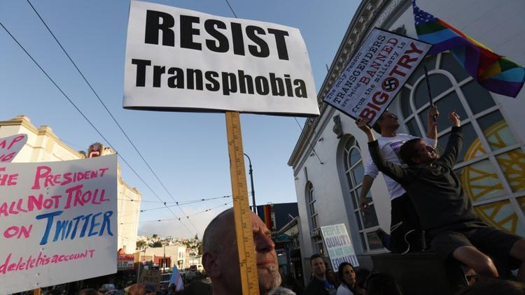 Protesters take to the streets against President Trump's announcement to ban transgender individuals from serving in the U.S. military. (Associated Press)