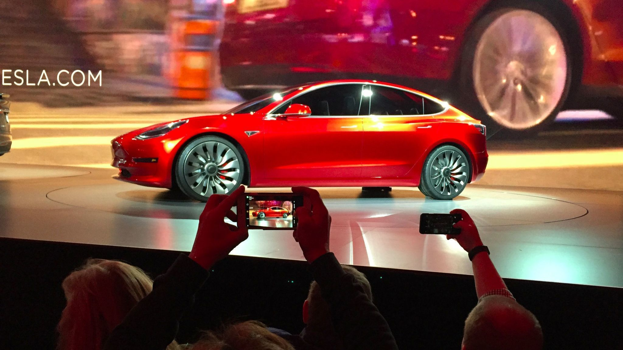 Elon musk takes the stage tonight to deliver the first tesla model 3s la times