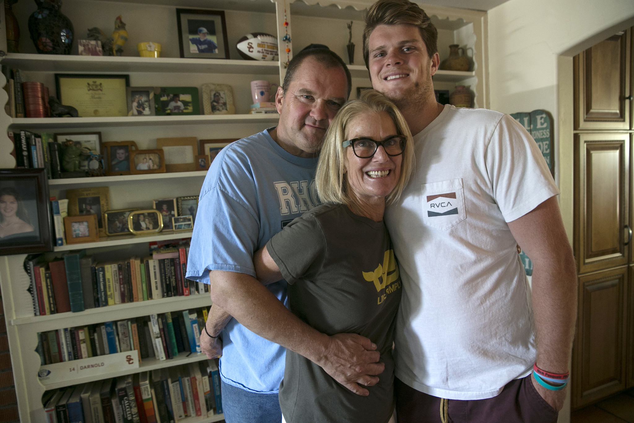 Sam Darnold with his mother, Chris, and father, Mike Darnold at their home in San Clemente.