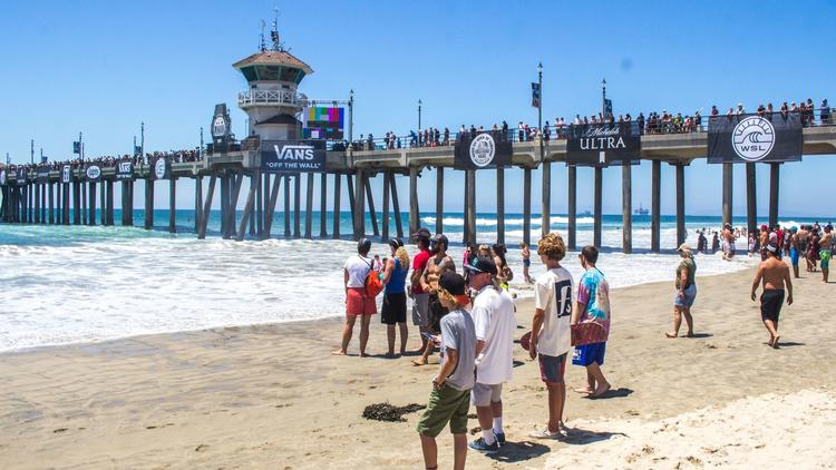 Surfing fans watch heats in junior men's division Saturday at the Vans U.S. Open of Surfing. The eve