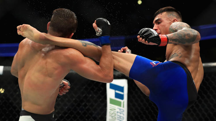 Adnre Fili lands a kick against Calvin Kattar during their featherweight bout. To see more images from UFC 214, click on the photo above. (Sean M. Haffey / Getty Images)