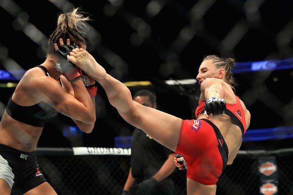 Alexandra Albu attempts to kick Kailin Curran during their strawweight fight at UFC 214. (Sean M. Haffey / Getty Images)