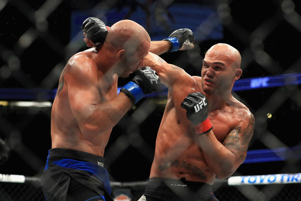 Donald Cerrone, left, and Robbie Lawler trade punches during their welterweight fight at UFC 214. (Sean M. Haffey / Getty Images)