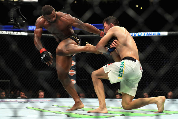 Tyron Woodley tries to fight off a takedown attempt by Demian Maia during their Wwlterweight title bout during UFC 214. (Sean M. Haffey / Getty Images)