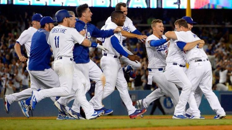 The Dodgers celebrate an 11th-inning win against the San Francisco Giants on July 30.