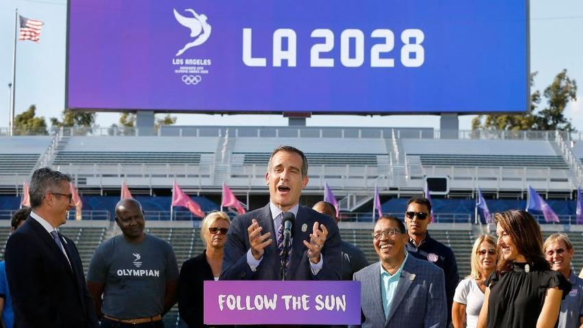 Mayor Eric Garcetti, center, speaks during a news conference about Los Angeles' 2028 Olympic bid. (Allen J. Schaben / Los Angeles Times)