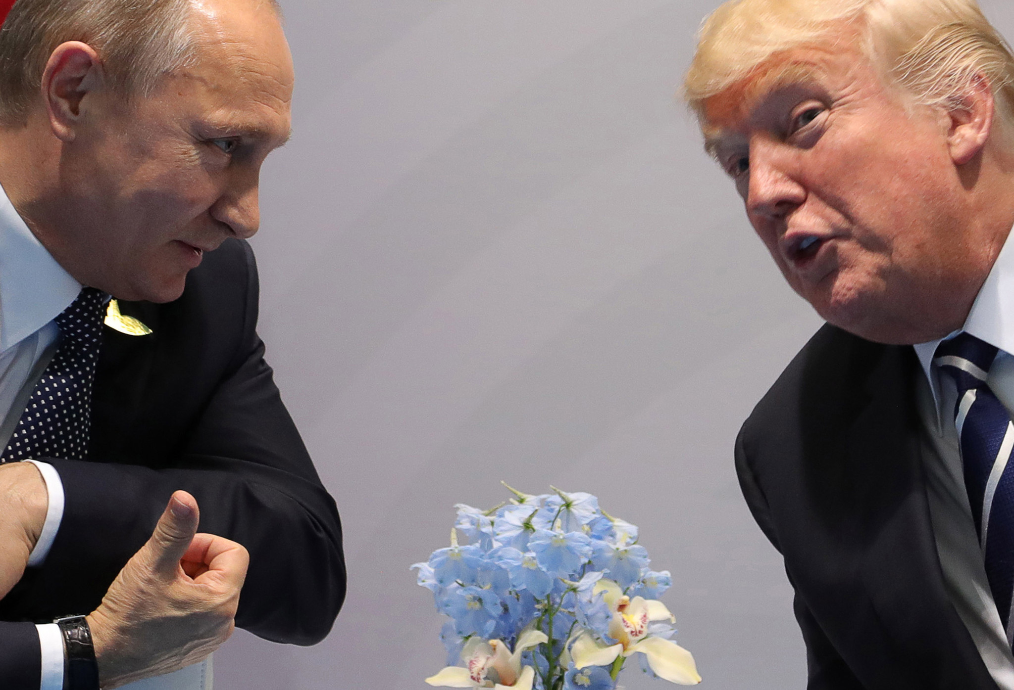 Russian President Vladimir Putin, left, and President Trump talk on the sidelines of the Group of 20 summit meeting in July in Hamburg, Germany.