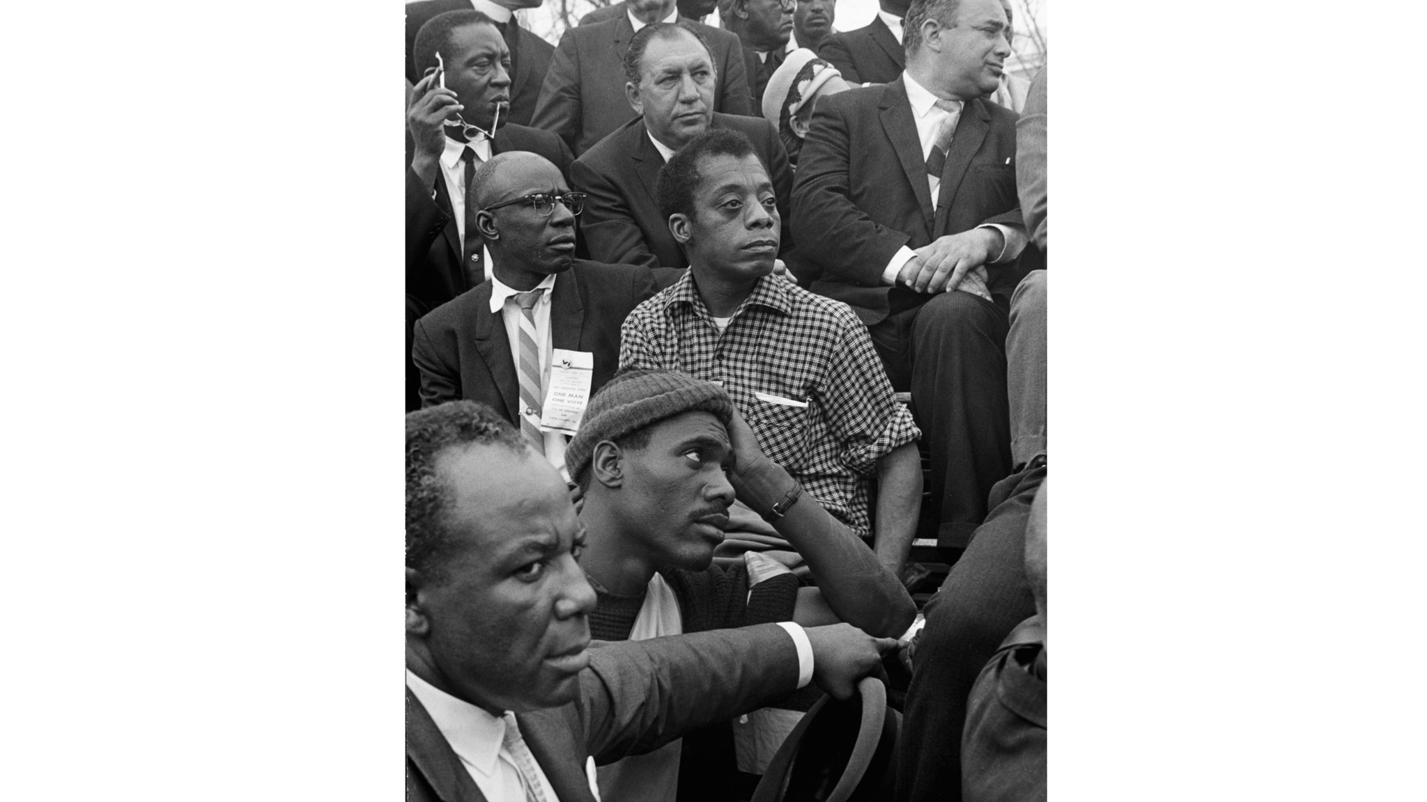 James Baldwin listens to the Rev. Martin Luther King, Jr. at the culmination of the march from Selma to Montgomery, Ala., in 1965.