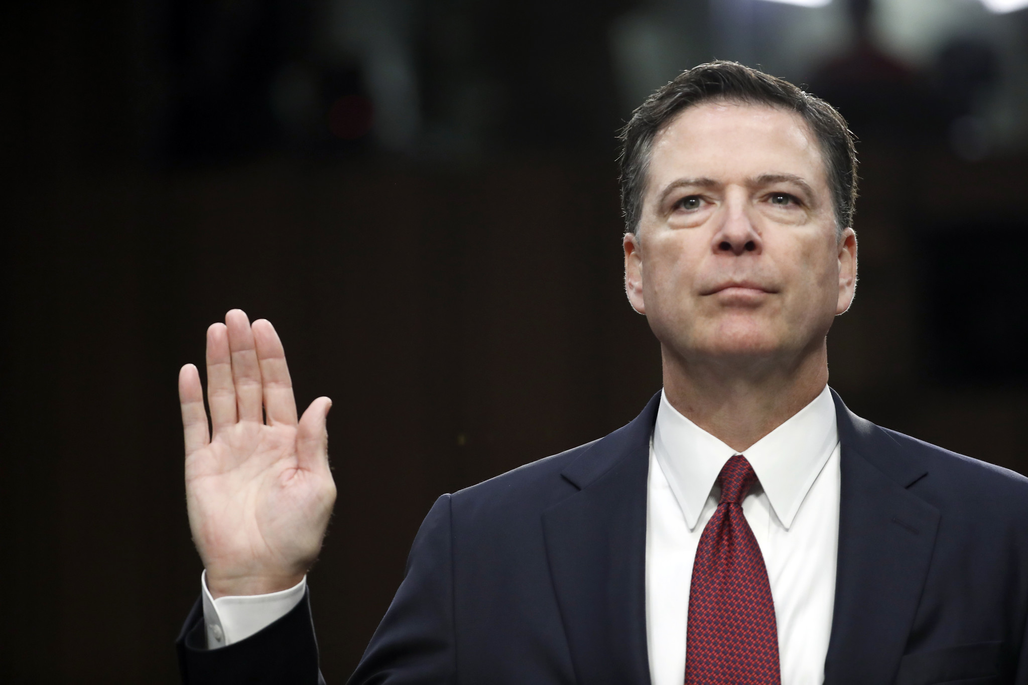 Former FBI Director James Comey is sworn in during a hearing before the Senate Select Committee on Intelligence in June.
