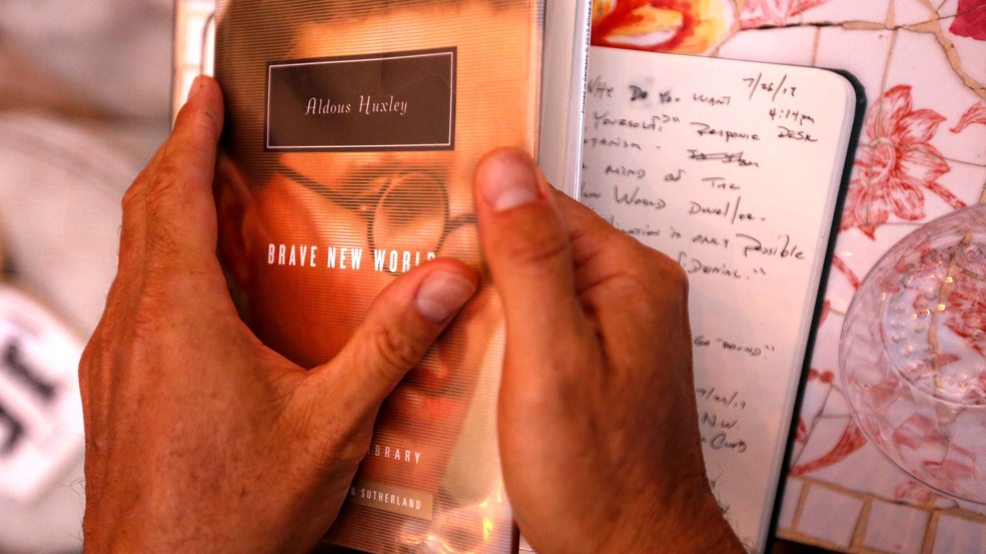 "Joshua Levine holds a copy of Aldous Huxley's ""Brave New World."""