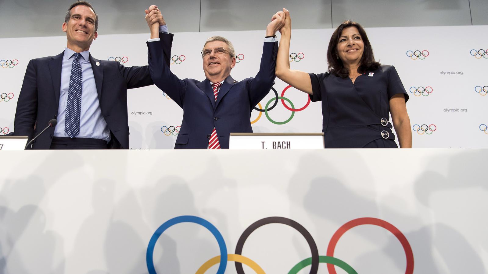 Los Angeles Mayor Eric Garcetti, left, celebrates with International Olympic Committee President Thomas Bach and Paris Mayor Anne Hidalgo. (Jean-Christophe Bott / AP)