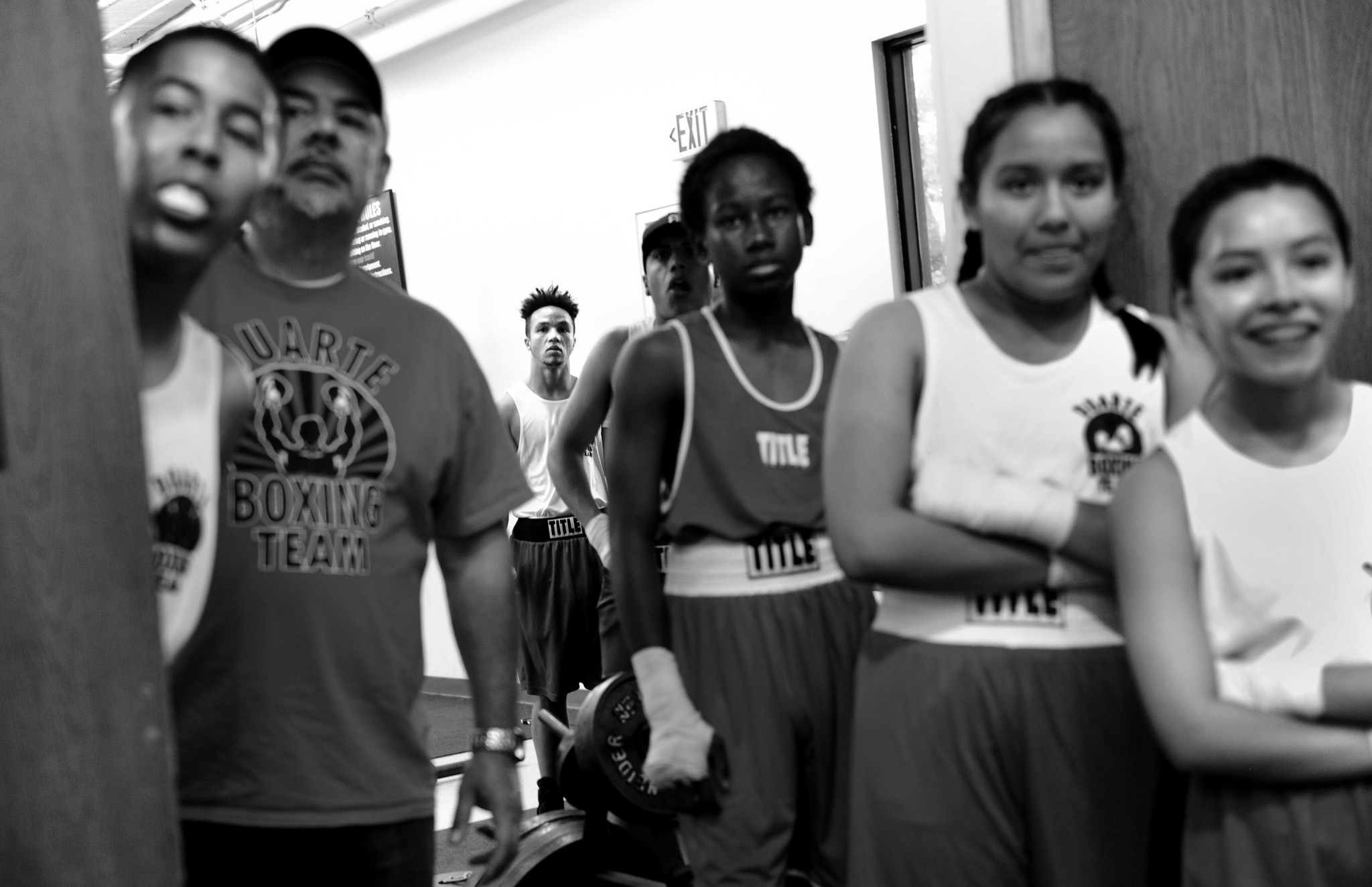 Pat Manuel watches a bout before stepping into the ring for the first time as a male during an exhibition match.