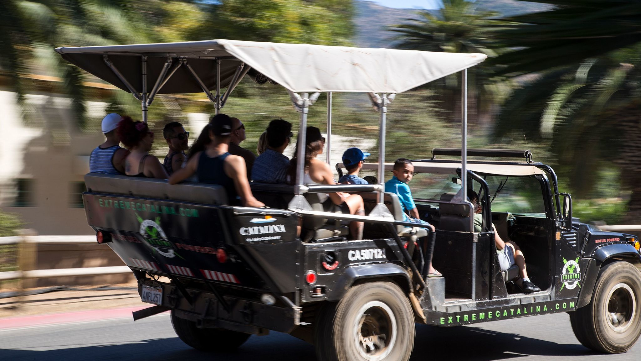 Customers are packed into a biofuel Hummer for a tour of the backcountry and sweeping views of Santa Catalina Island.