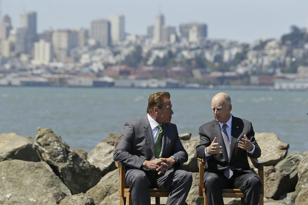 Former Gov. Arnold Schwarzenegger sits with Gov. Jerry Brown on Treasure Island last month before the signing of new climate change legislation. (Eric Risberg / Associated Press)