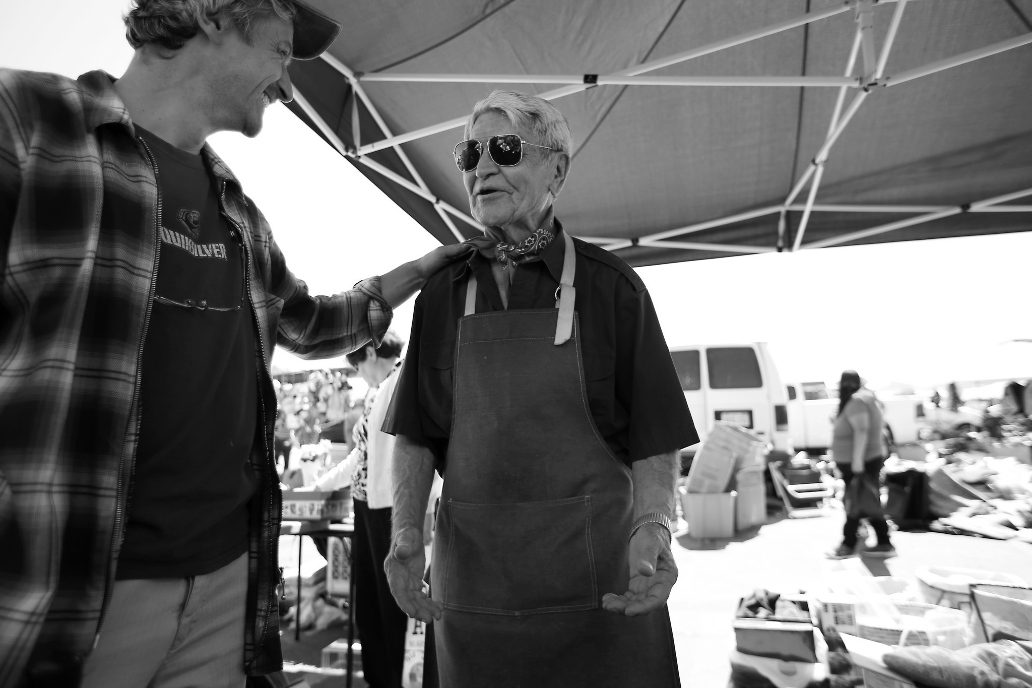 Jozsi Baky, left, helps Steve Hideg at the Alpine Village Swap Meet in Torrance to sell some of his belongings for food and medicine.