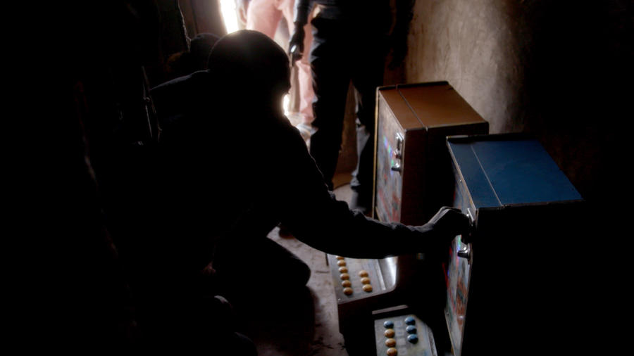Half of the population in Ghana's Northern Region lives below the poverty line, yet the slot machines are almost everywhere. — Photograph: Noah Fowler/Los Angeles Times.