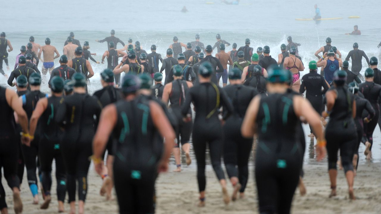 Swimmers make their way into the water during the Nautica Malibu Traithlon.