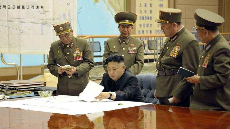 North Korean leader Kim Jong Un holds an operations meeting in 2013.