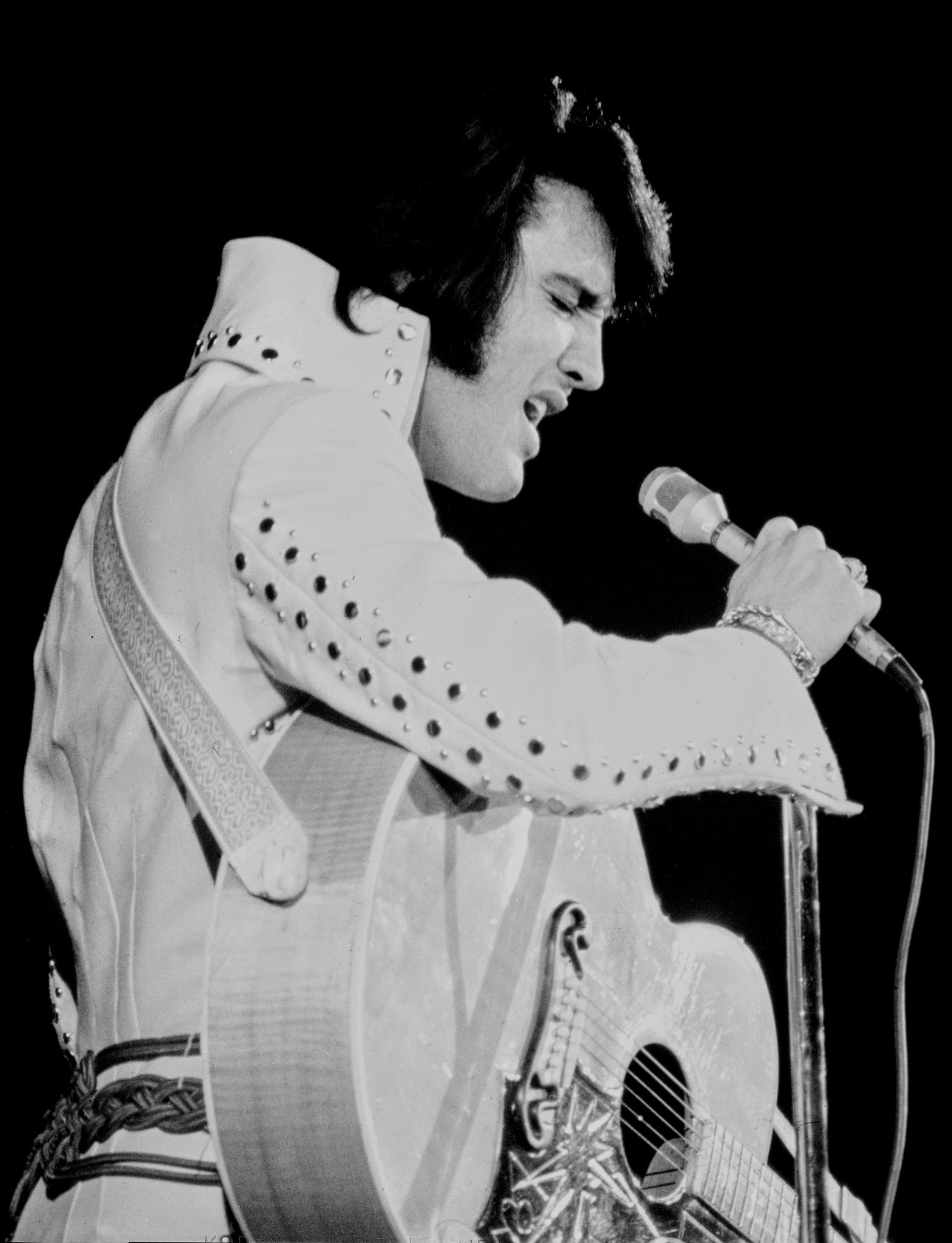 During the 1970s. Elvis was famous for his jewel-encrusted jumpsuits. He's seen here performing at the International on Aug. 17, 1971.