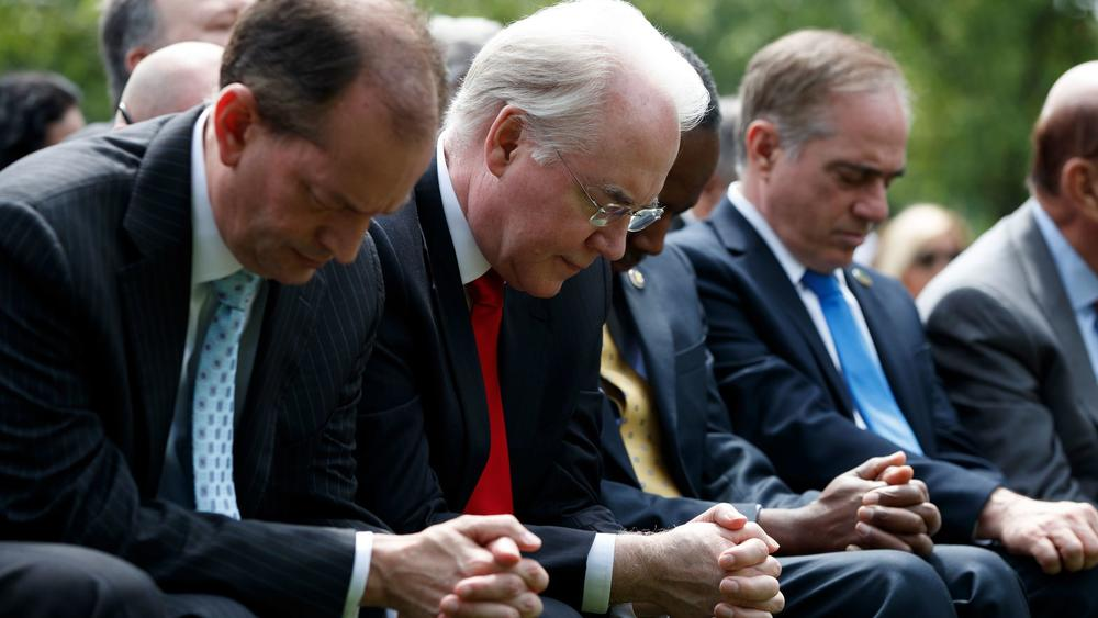 Labor Secretary Alexander Acosta, Health and Human Services Secretary Tom Price, Housing and Urban Development Secretary Ben Carson and Veterans Affairs Secretary David Shulkin pray in the Rose Garden of the White House in Washington on May 4th. — Photograph: Evan Vucci/Associated Press.