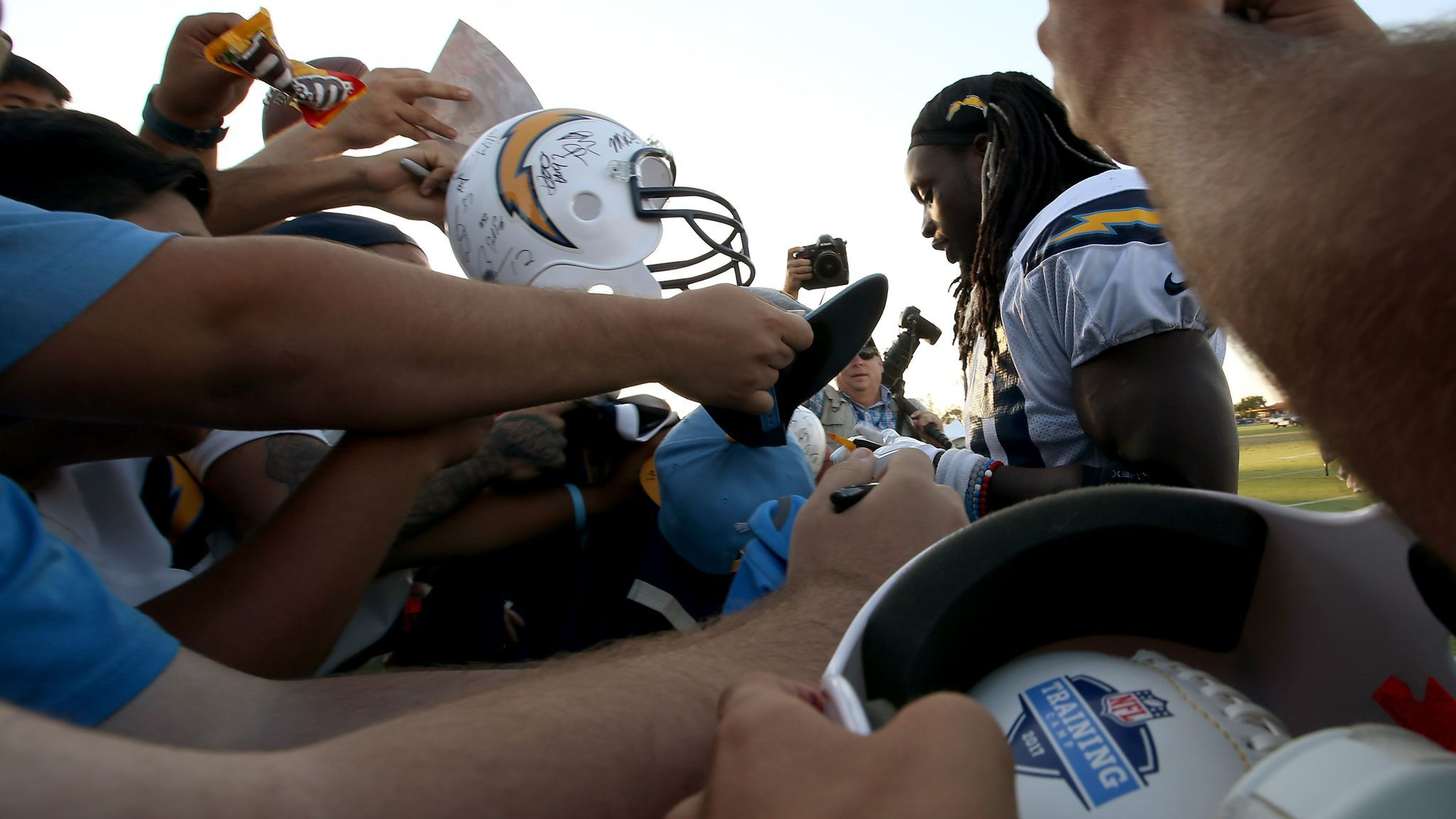 Chargers running back Melvin Gordon signs autographs.