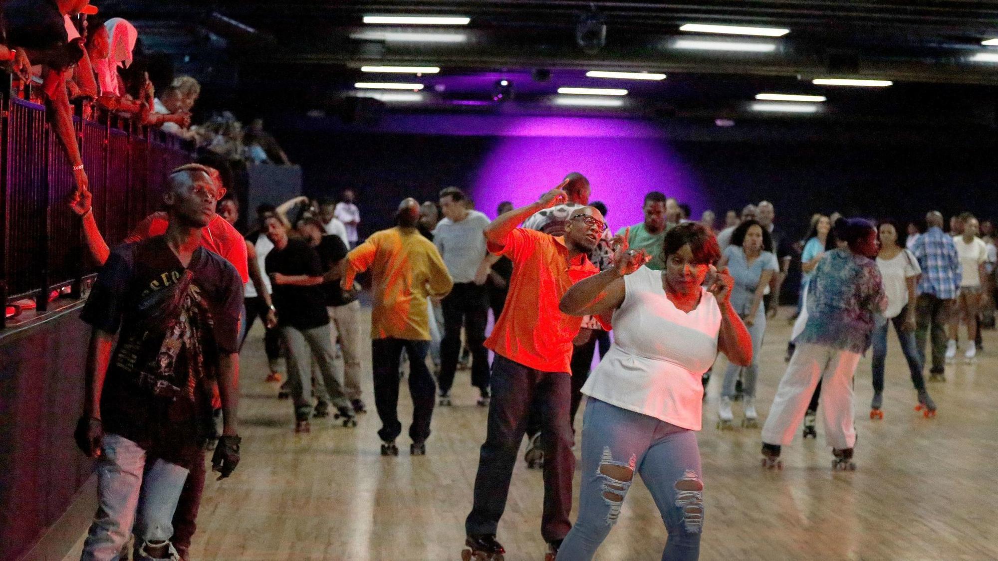 Rapper Nipsey Hussle helps beloved Mid-City roller rink World on Wheels get rolling again