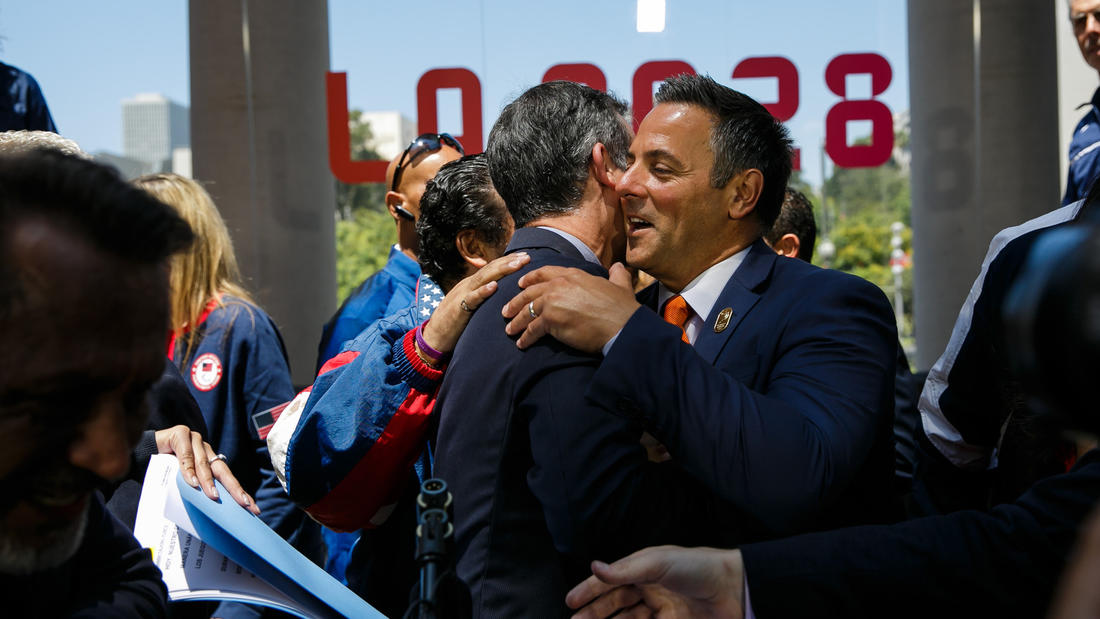 Los Angeles Mayor Eric Garcetti is congratulated by council member Joe Buscaino at a news conference to announce the city's approval of a deal to host the 2028 Olympics. (Marcus Yam / Los Angeles Times)