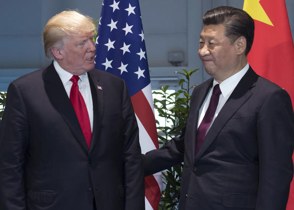 President Donald Trump and China's President Xi Jinping in July. (Saul Loeb / Associated Press)