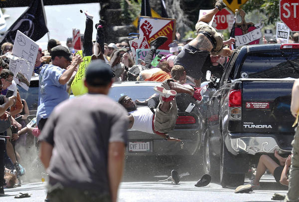 Vehicle plows into marchers after violent clashes at Virginia white nationalist rally