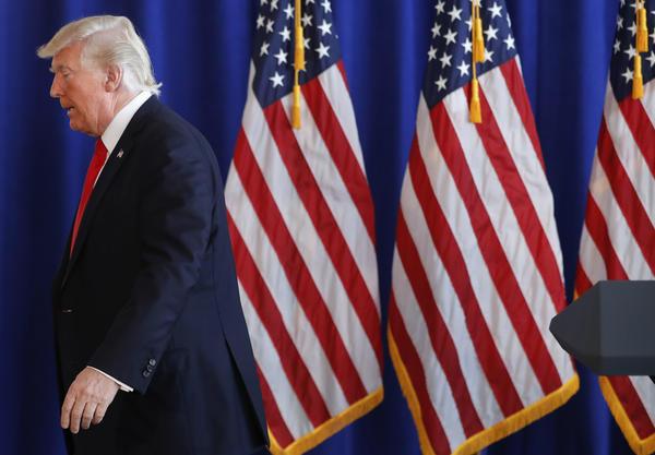 Trump says blame belongs 'on many sides' amid deadly Klan violence in Virginia
