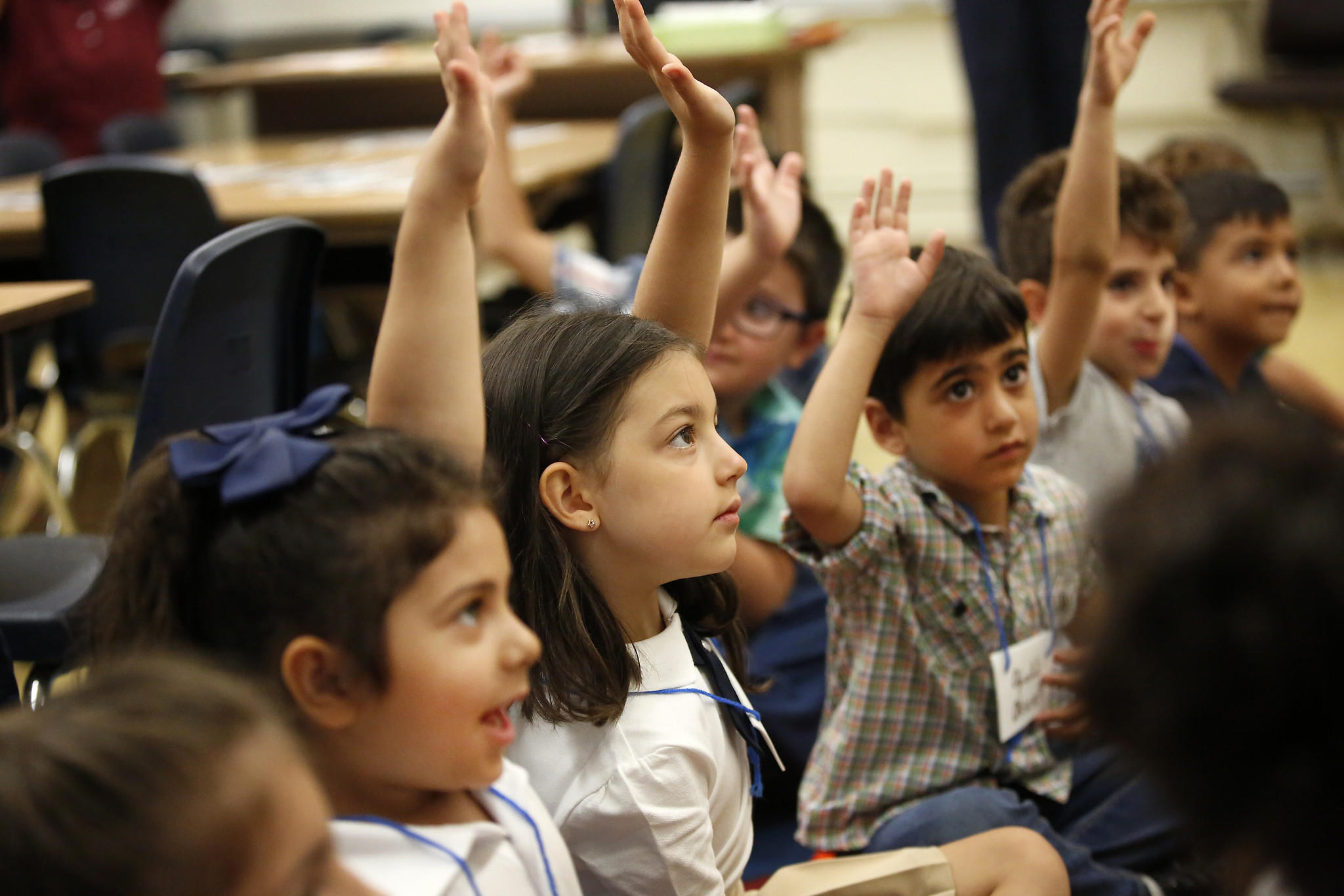 Kindergarten student Mary Saroyan, center, raises her hand in LAUSD's first English/Armenian dual-language program at Mountain View Elementary School in Tujunga. (Al Seib / Los Angeles Times)