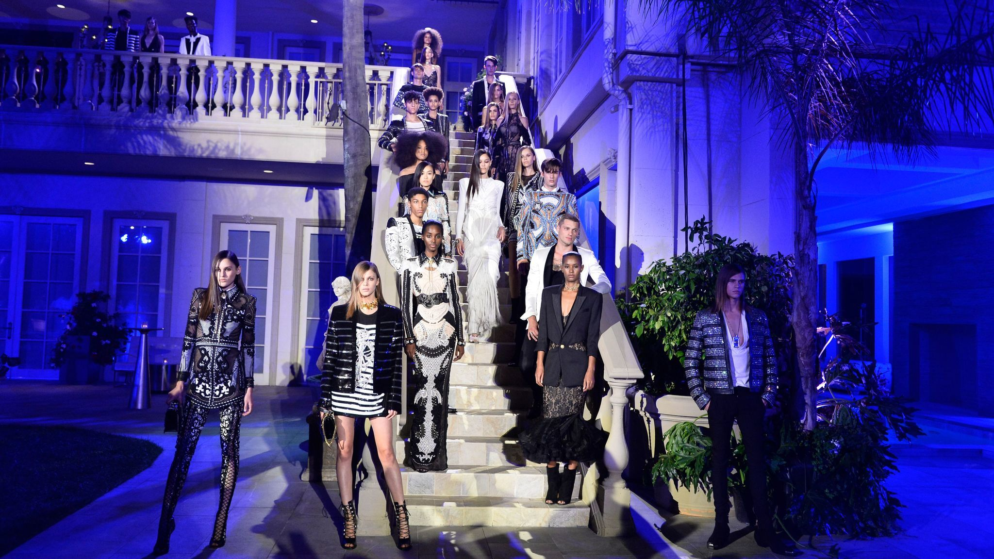 Models walk the outdoors runway at the Balmain celebration party for the opening of the brand's first Los Angeles boutique and its Beats by Dre collaboration on July 20 in Beverly Hills.
