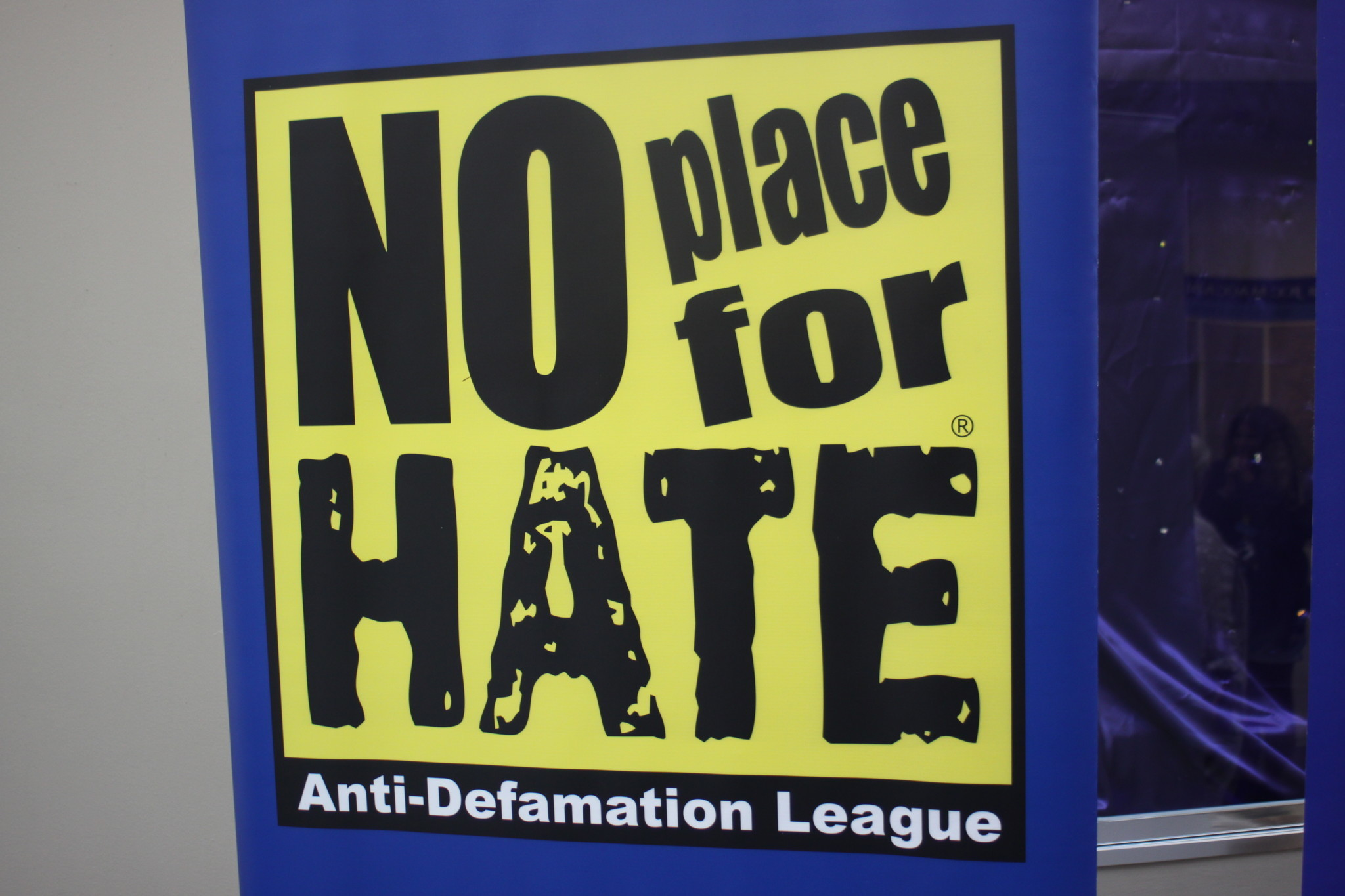 "Banners with the Anti-Defamation League of San Diego's motto ""No Place for Hate"" hang at the entrances"