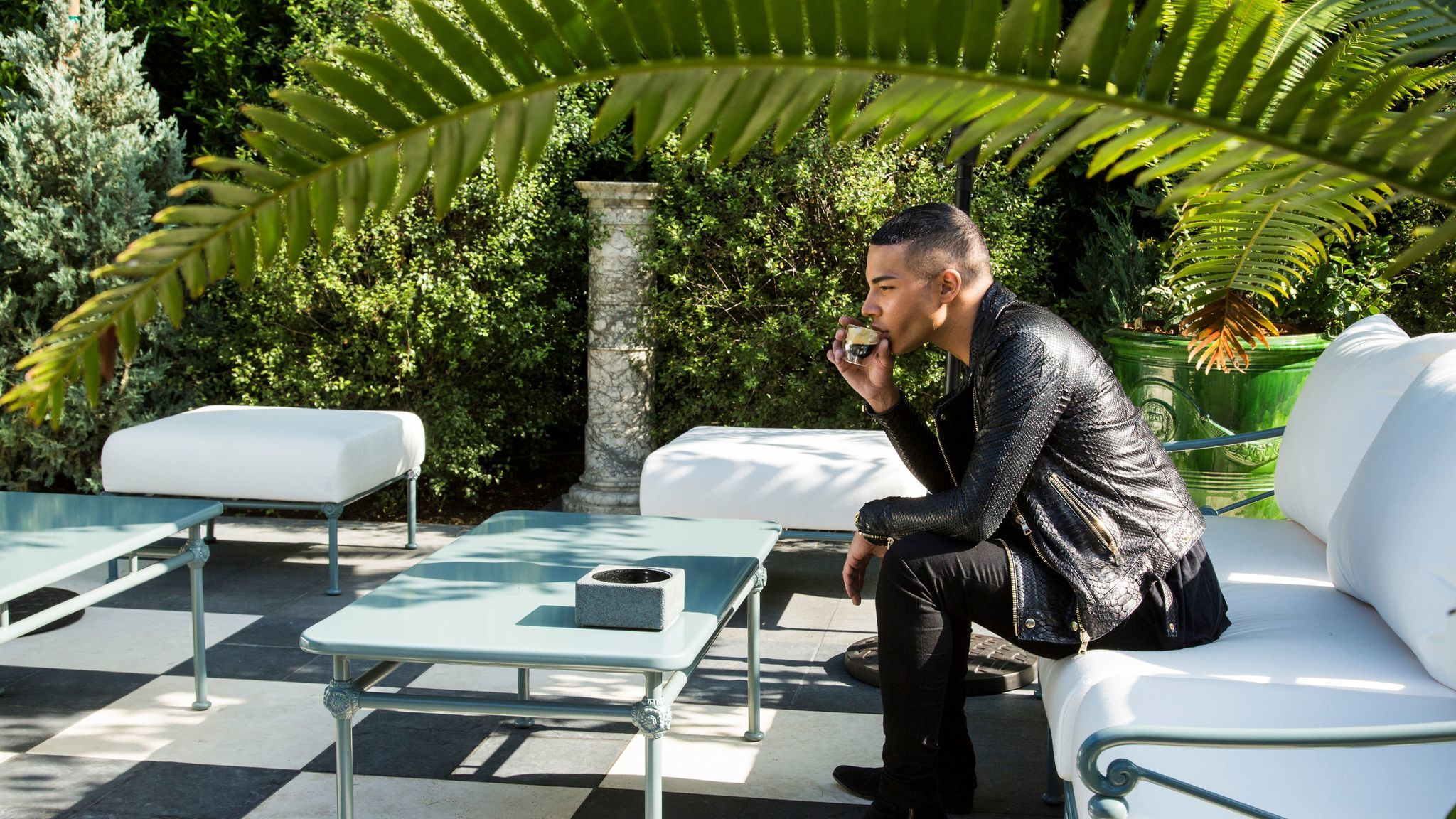 Rousteing taking a break in the outside garden at Balmain's new flagship store in Los Angeles.