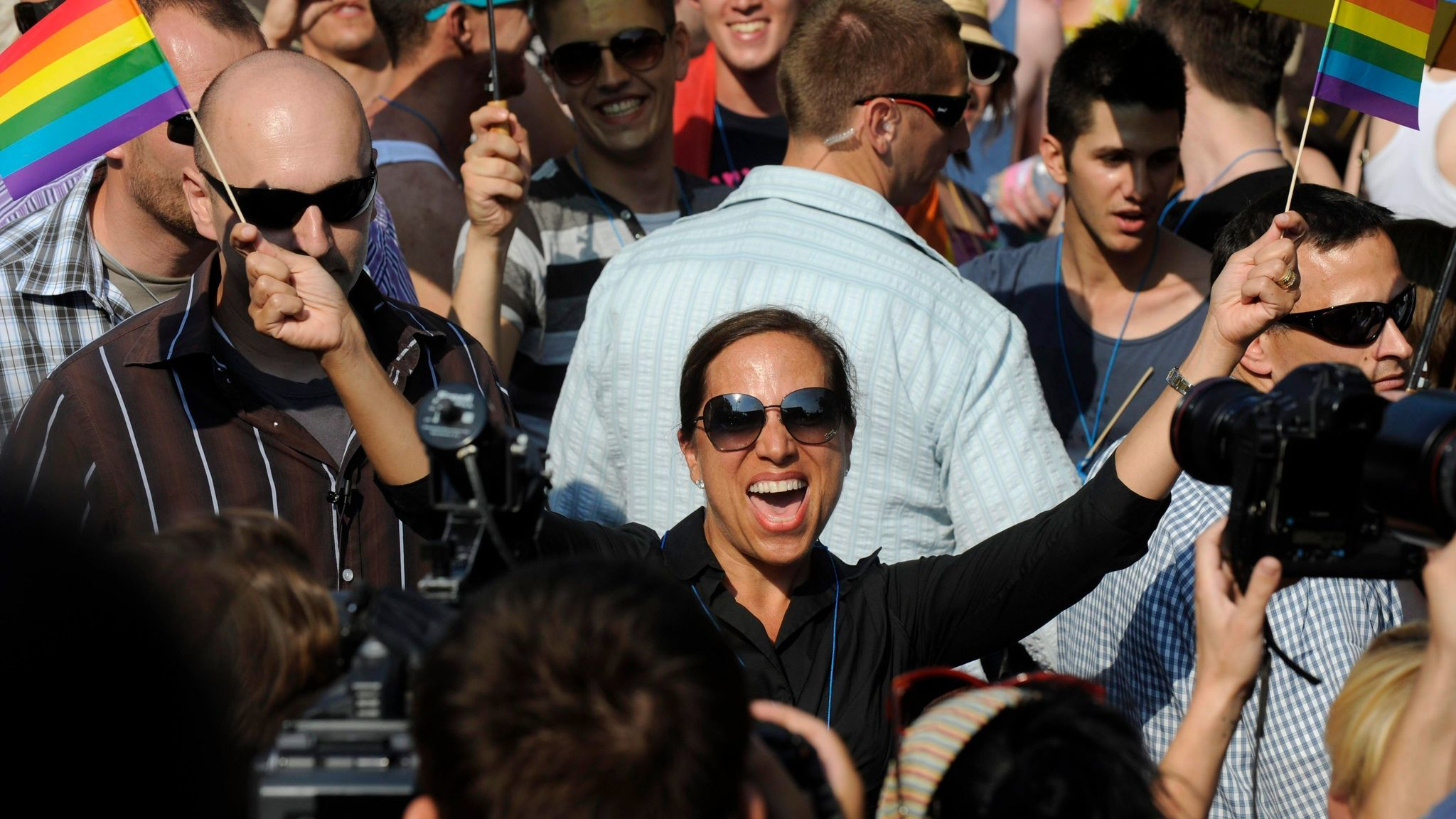 Eleni Tsakopoulos Kounalakis, then the U.S. ambassador to Hungary, waves rainbow flags at a gay pride march in Budapest in 2012. She's now running for lieutenant governor in California.