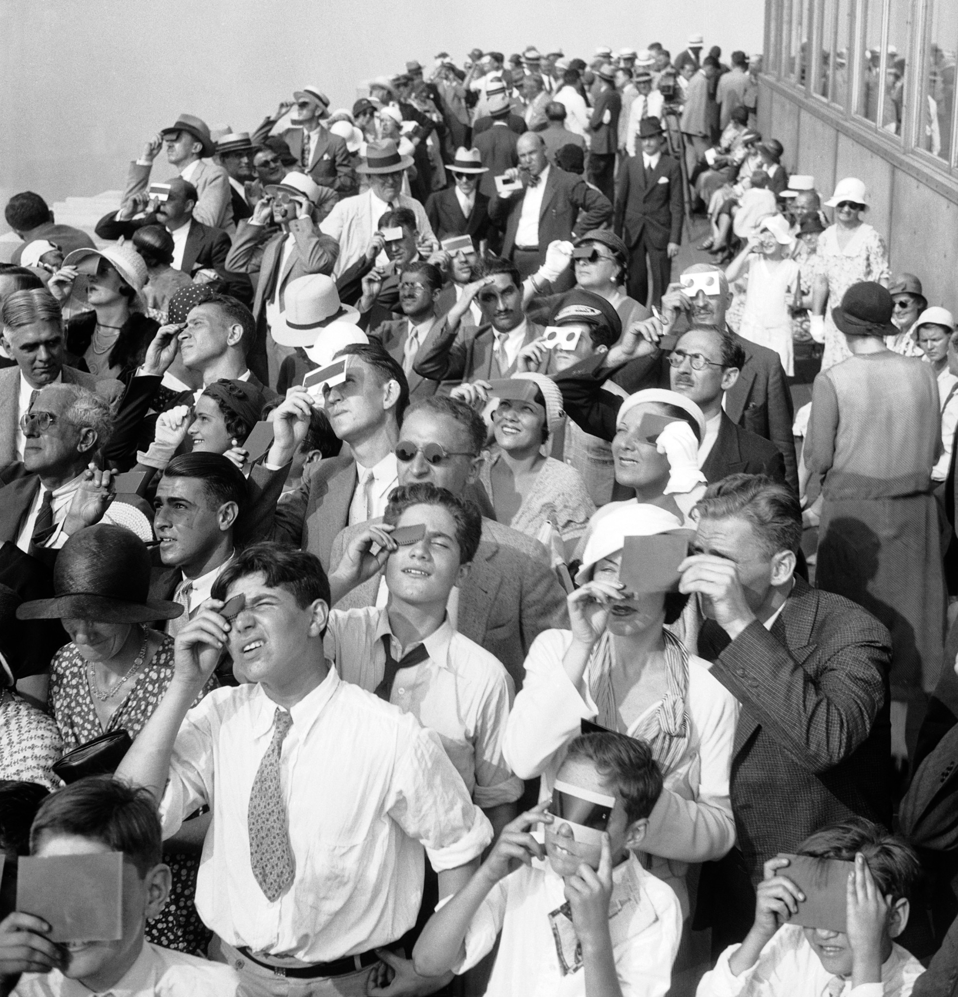 Watching a partial solar eclipse in New York City, 1932. (Associated Press)