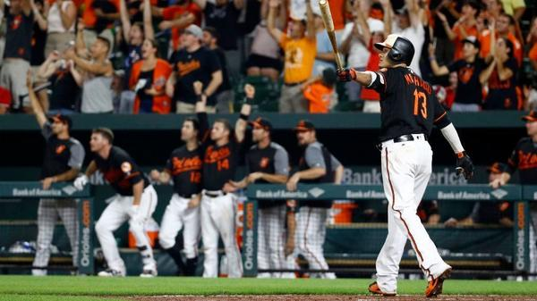 Manny Machado hits three home runs, including a walk-off grand slam, in Angels